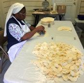 woman making altar bread