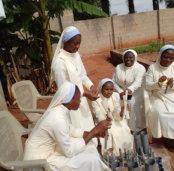 nuns making candles