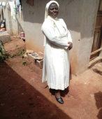 An adult nun in church