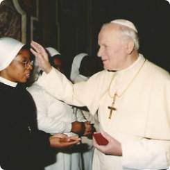 Saint Pope John Paul II was blessing Mother Catherine; when she was in Rome-Italy